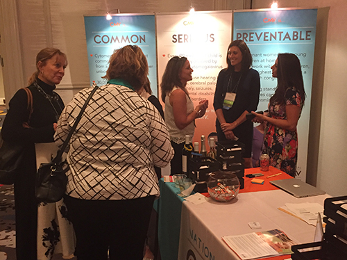 2016 CMV Conference Reception, gathering around the National CMV Foundation exhibit